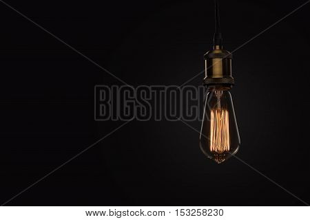 Classic Edison Light Bulb On Black Background