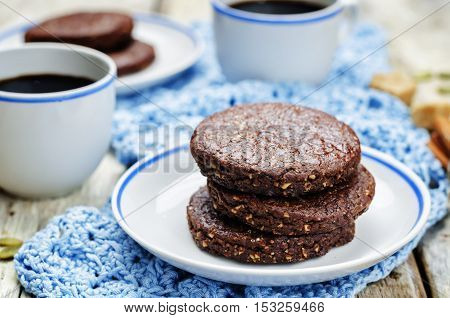 Mexican chocolate Pepita shortbread cookies on wood background
