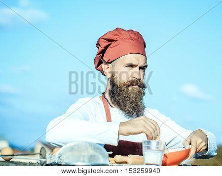 Man Chef Mixing Up Ingredients