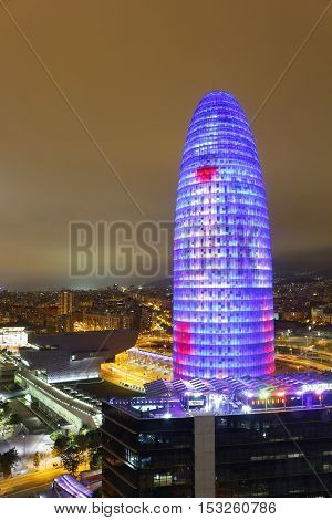 Illuminated Agbar Tower And City Of Barcelona, Spain