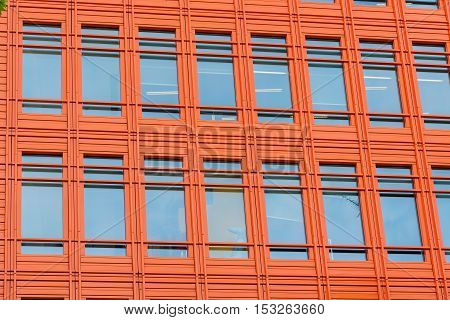 Orange fronted office building in the city