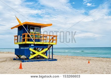 South Beach, Miami, Florida, Lifeguard House In A Colorful Art Deco Style On Cloudy Blue Sky