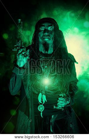 Fantasy pirate, risen from the dead. Pirate zombie in hell green light. Halloween.