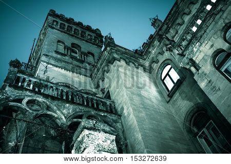 Spooky dark castle house hallowen, bright windows