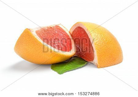 Two wedges of grapefruit on white background.