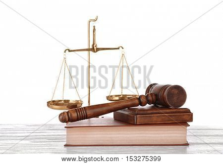 Gavel with book and scales on white background