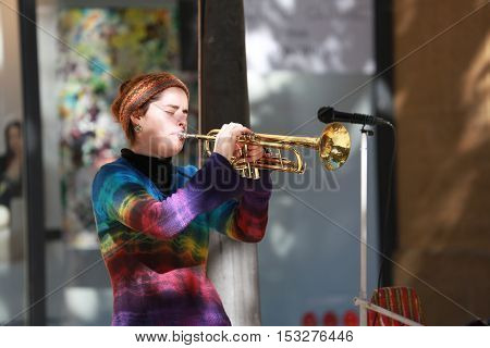 Aix-En-Provence France - October 21 2016: Young Woman Playing the Trumpet in the Street (Cours Mirabeau) in Aix-En-Provence France