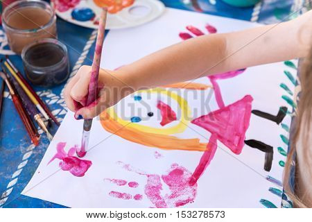 Children finger's painting, Little girl painting with a roller and fingers