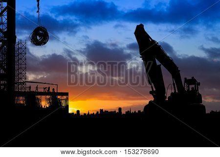 Construction Work Slhouette At Sunrise