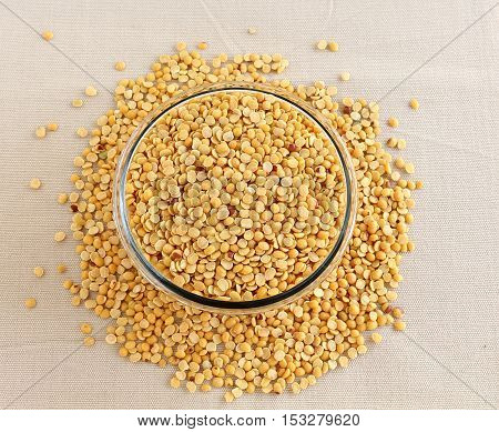 Toor dal, also known as split pigeon pea, rich in proteins, in a glass bowl.