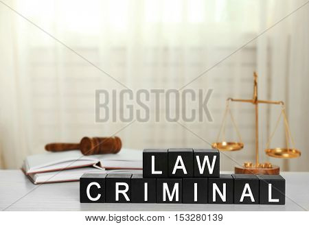 Black cubes with phrase LAW CRIMINAL on white table