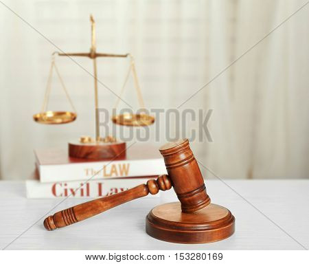 Symbols of law and justice on white table