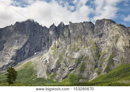 Norway landscape. Troll wall massif mountain Trollveggen. Romsdalen valley. Cloudy