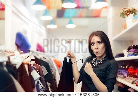 Woman Checking Price Tag on Sale in Clothing Store poster