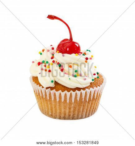 Muffin With Cream And Maraschino Cherry, Decorated With Colorful Candy Sprinkles