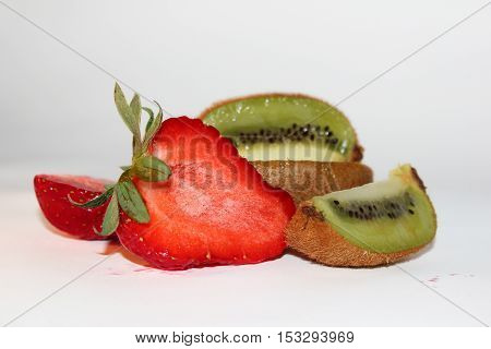 composition with cutting strawberries and kiwi on a white background