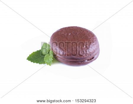 choco pie chocolate coated snacks isolated on white.  Chocolate cookies with mint leaves