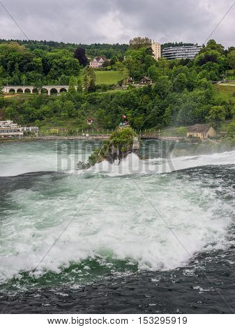 The Rhine Falls in cloudy weather in Neuhausen am Rheinfall Schaffhausen Switzerland. The Rhine Falls is the largest waterfall in Europe.