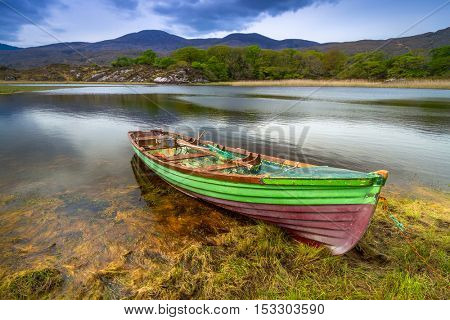 Landscape with boat at the Killarney lake in Co. Kerry, Ireland