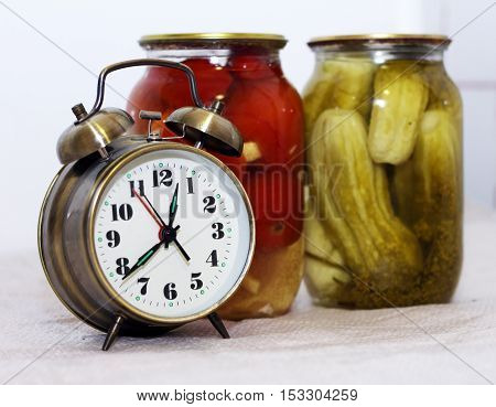 golden alarm clock and Pickled Vegetables retro object