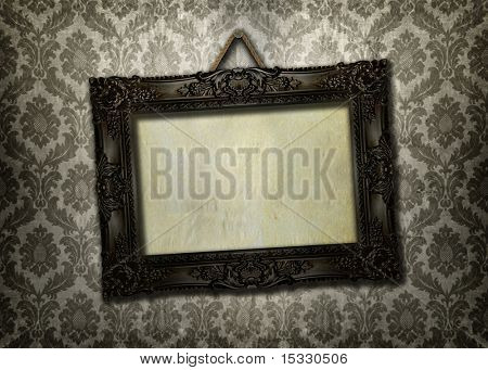 Beautiful ornate frame on a vintage wallpaper