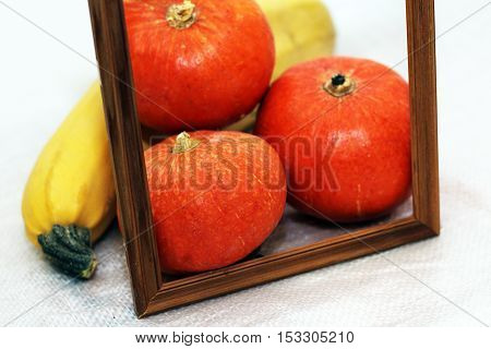 photo frame and vegetables fresh pumpkin wooden decor