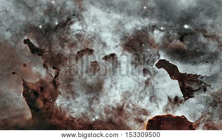 Dust Pillars in the Carina Nebula, also known as the Grand Nebula. Large bright nebula that has within its boundaries several related open clusters of stars. Elements of this image furnished by NASA.
