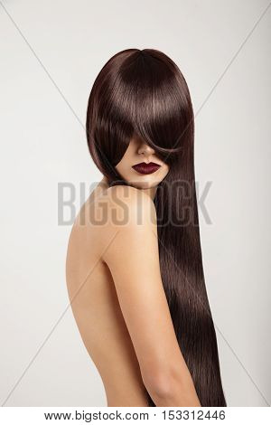 Woman With A Long Straight Hair Covered Her Face But Shows Beuty Lips