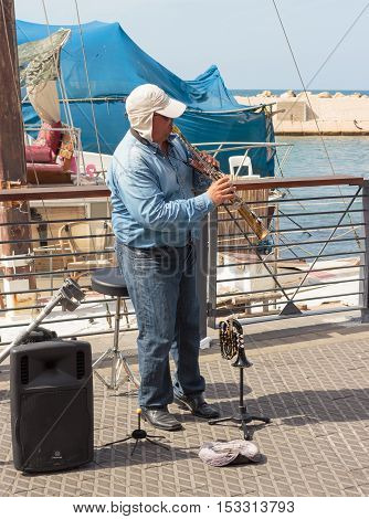 Street Musician Playing The Clarinet On The Waterfront In Yafo