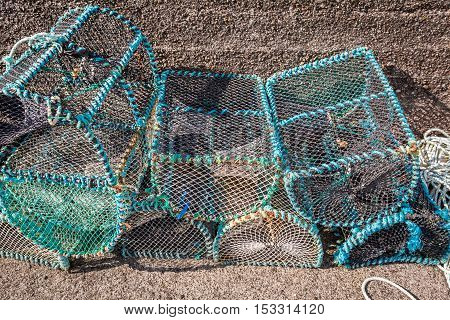 Colored Fishing Cage And Bay With Boats In Scotland