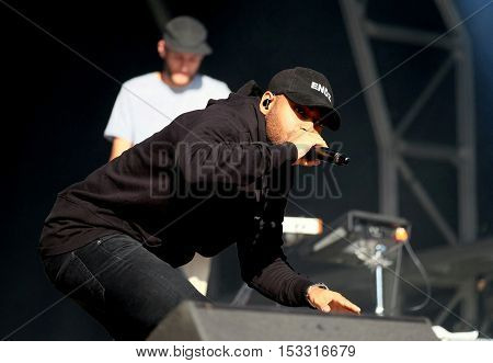 NEWPORT, ISLE OF WIGHT, UK - SEPTEMBER 9 2016: British rapper Kano , aka Kane Brett Robinson performing on stage at Bestival festival on the Isle of Wight