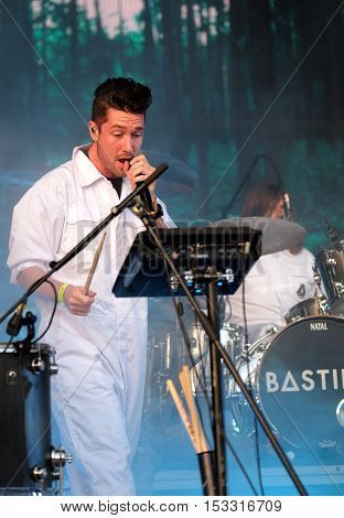NEWPORT, ISLE OF WIGHT, UK - SEPTEMBER 11 2016: Lead singer Dan Smith  performing on stage with Bastille at Bestival festival on the Isle of Wight