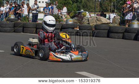 GALATI ROMANIA - September 11 2016: Boy drive karting car on a track to demonstrate the spectators the speed