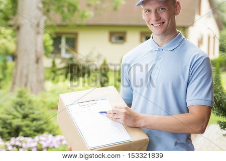 Courier Holding A Parcel And A Clipboard