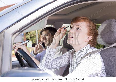 Women Putting Mascara While Driving