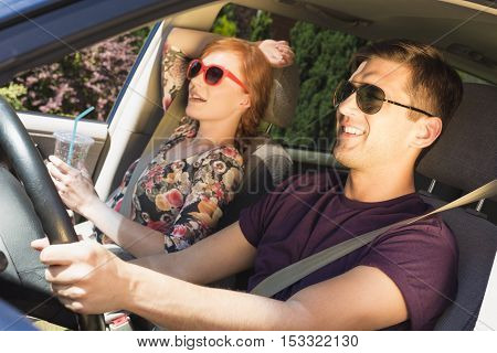 Young Man And A Woman On A Passenger Seat In Car