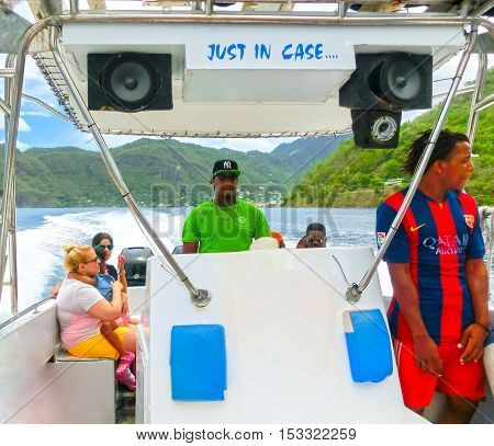 Saint Lucia Saint Lucia - May 12 2016: The people enjoying of boat trip to the mountains Pitons near a beautiful caribbean beach at Saint Lucia island at Caribbean