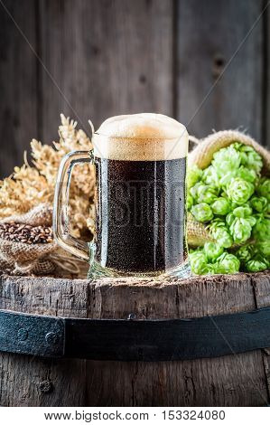 Pint Of Fresh Dark Beer With Ingredients
