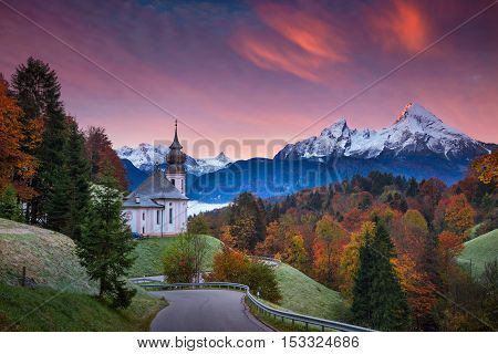 Autumn in Alps. Image of  the european Alps with Maria Gern Church during beautiful autumn sunrise.