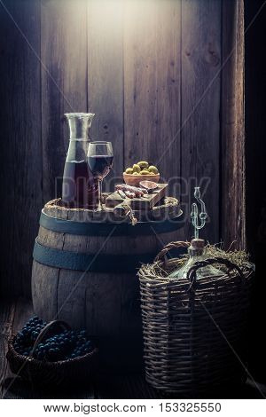Wine In Glass With Olives, Cold Meats And Grapes With Copy Space