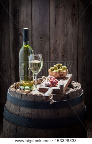 Fresh White Wine With Olives And Cold Cuts