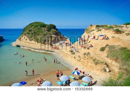 People at the Canal d' amour beach on Corfu island, Greece