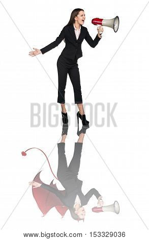 Business woman screams with loudspeaker and devil reflection isolated on white