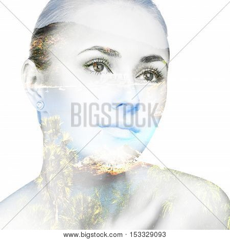Double exposure portrait of a beautiful young woman and summer place