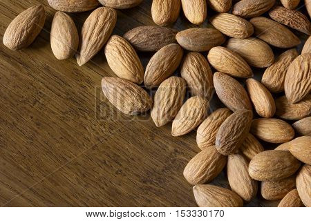 Nuts almonds on a wooden board close-up shot