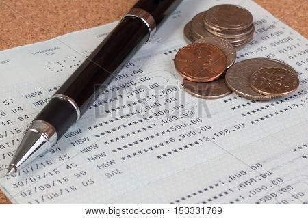 Passbook Or Passbook Saving Account, Passbook Bank Statement. Coin Stack On Account Passbook Or Book