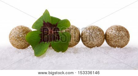 Christmas decoration with snow isolated on white background.Lucky symbols: four-leaf clover and balls . Green cloverleaf and decoration.