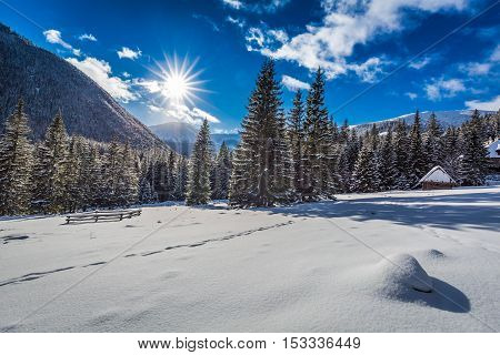 Small Wooden Cabin Covered By Snow In Winter At Sunrise, Tatras, Poland