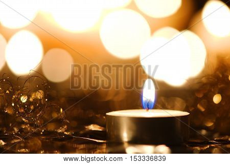 Christmas candlelight decoration against blurred background of bright lights