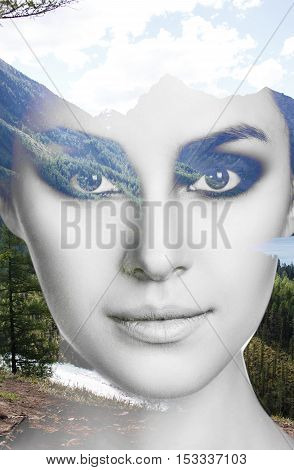 Double exposure portrait of young woman with make-up and nature